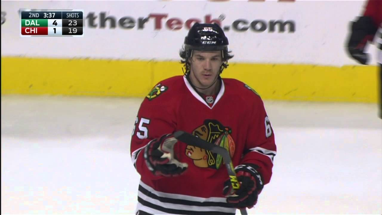 Blackhawks' Andrew Shaw bunts puck out of air baseball style