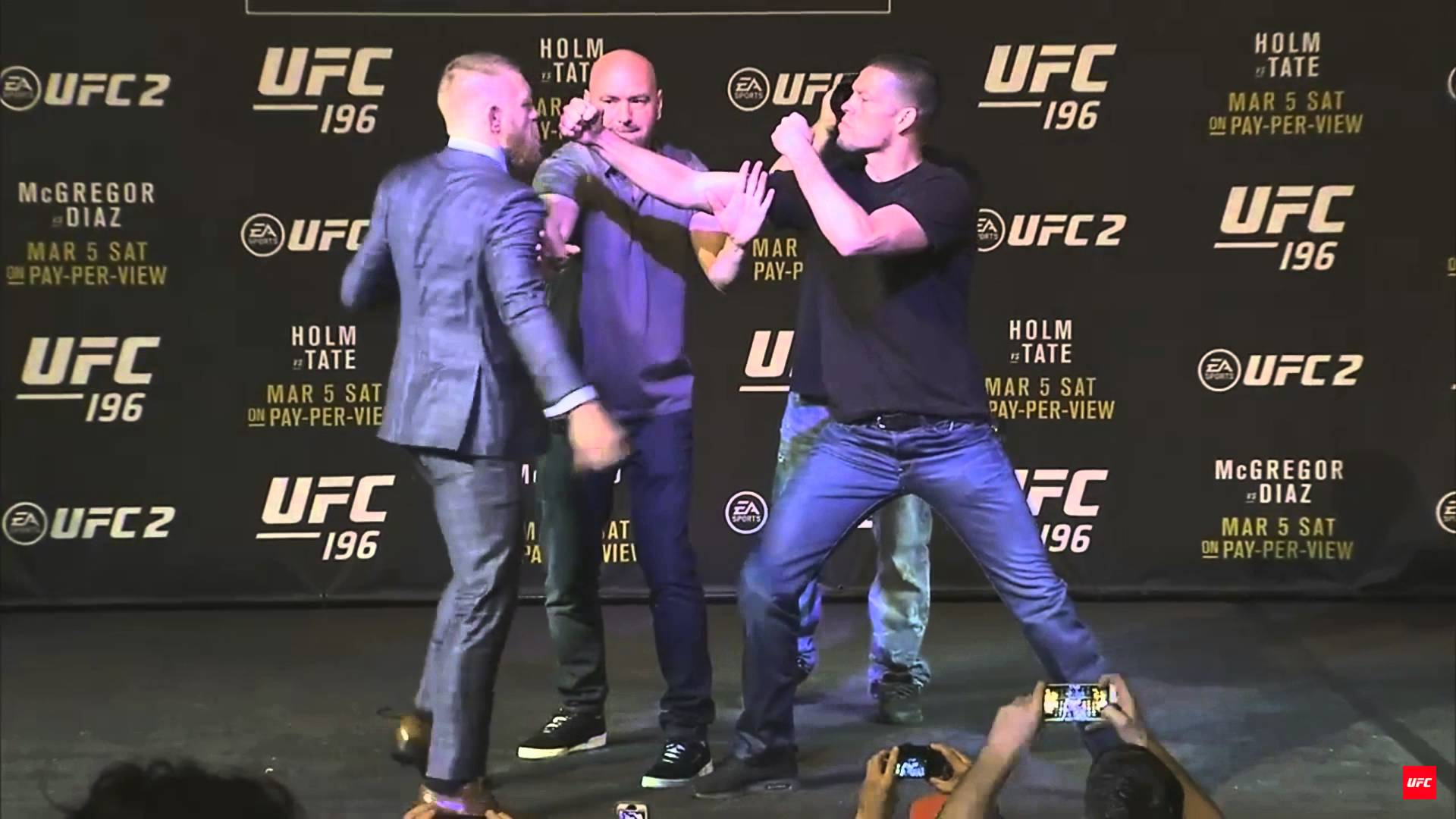 Conor McGregor swings at Nick Diaz in UFC 196 face off