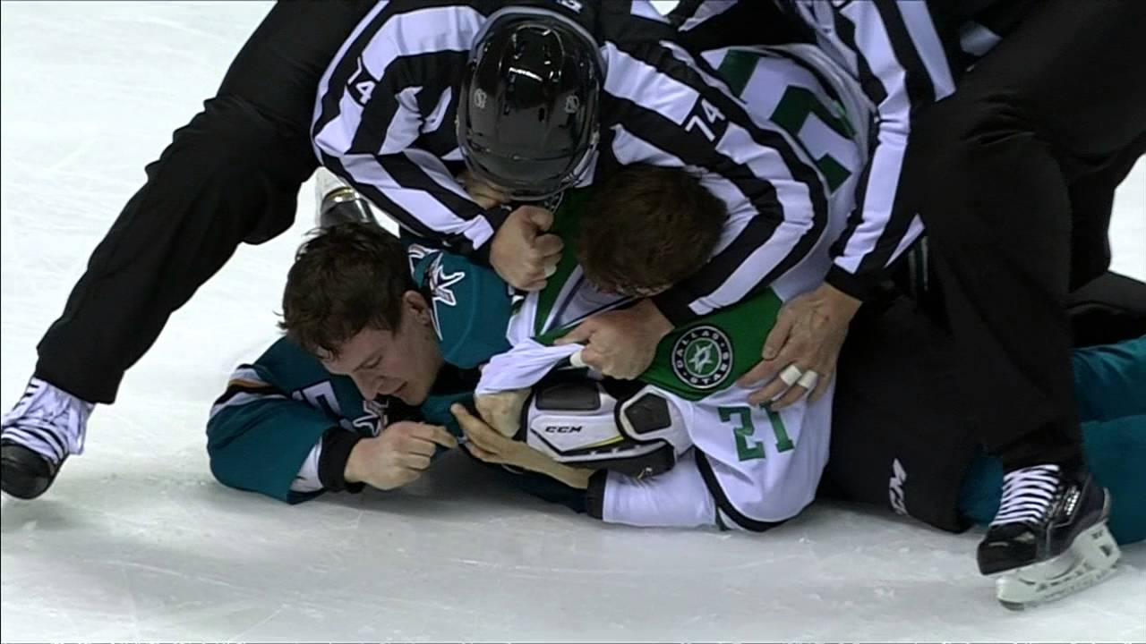 Dallas Stars' Roussel grabs San Jose Sharks' Wingels hair during fight