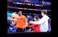 Kevin Seraphin trucks young fan during warm ups
