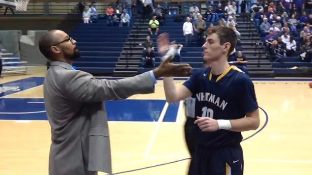 College basketball coach has a cool handshake with all of his players