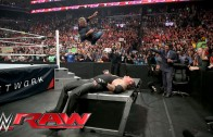 Shane McMahon elbow drops The Undertaker through table