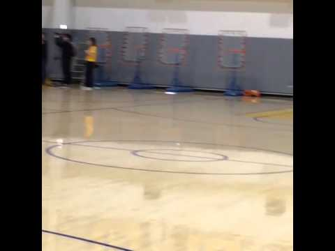 Stephen Curry hits full court golf putt