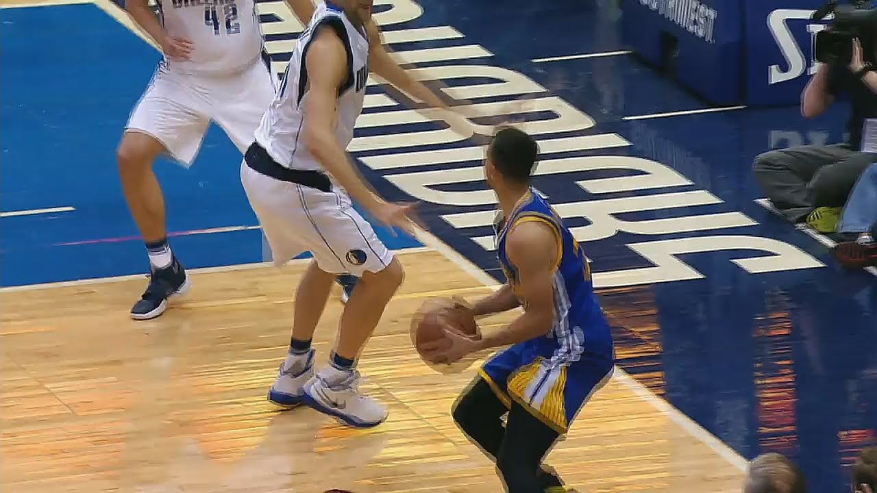Stephen Curry hits the 3 pointer over Dirk Nowitzki