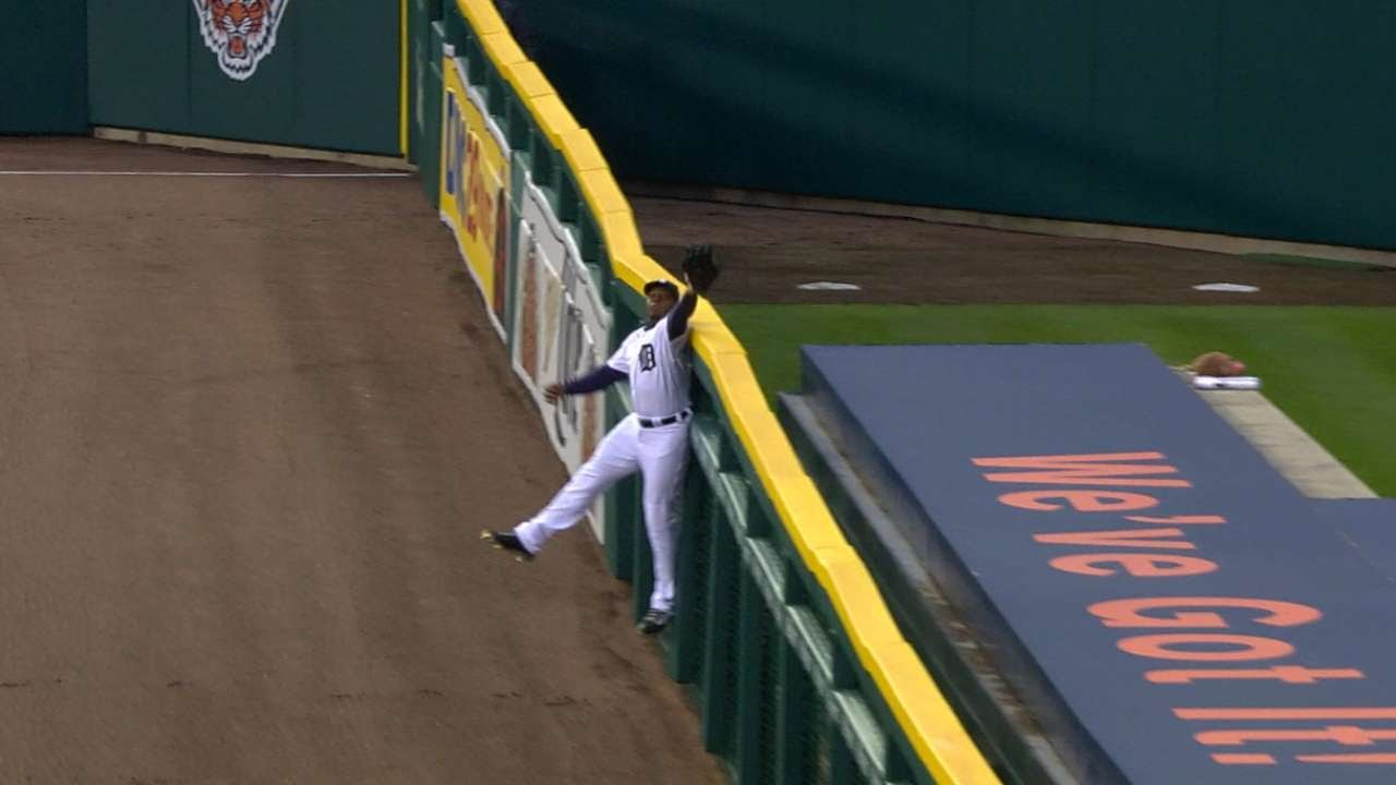 Justin Upton tips ball to himself to rob a home run