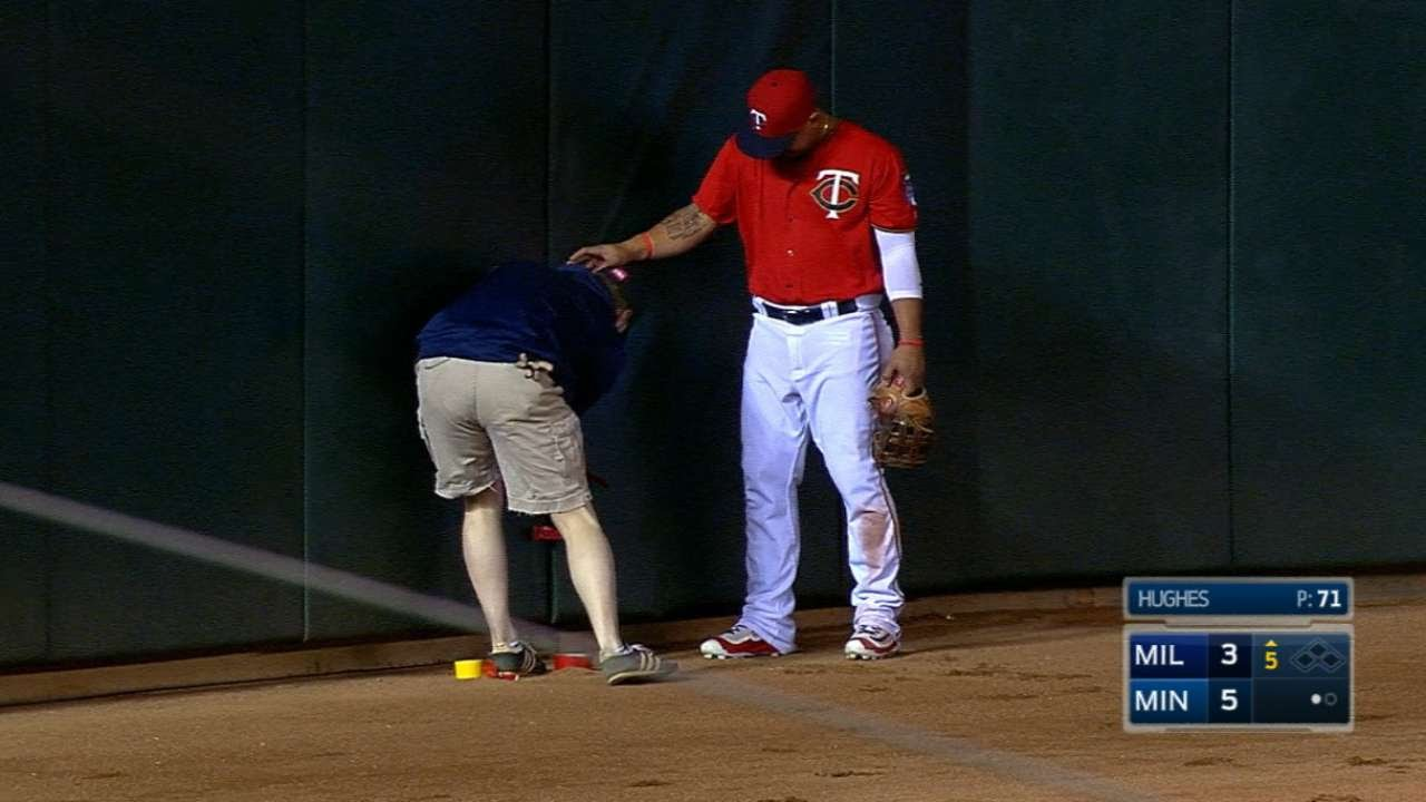 Minnesota Twins staff bring out the duct tape to tape outfield wall