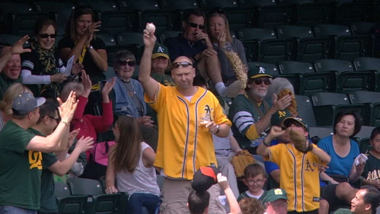 Oakland A's fan snags foul ball while holding his beer