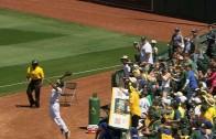 Oakland Athletics ball boy makes a nice jumping catch