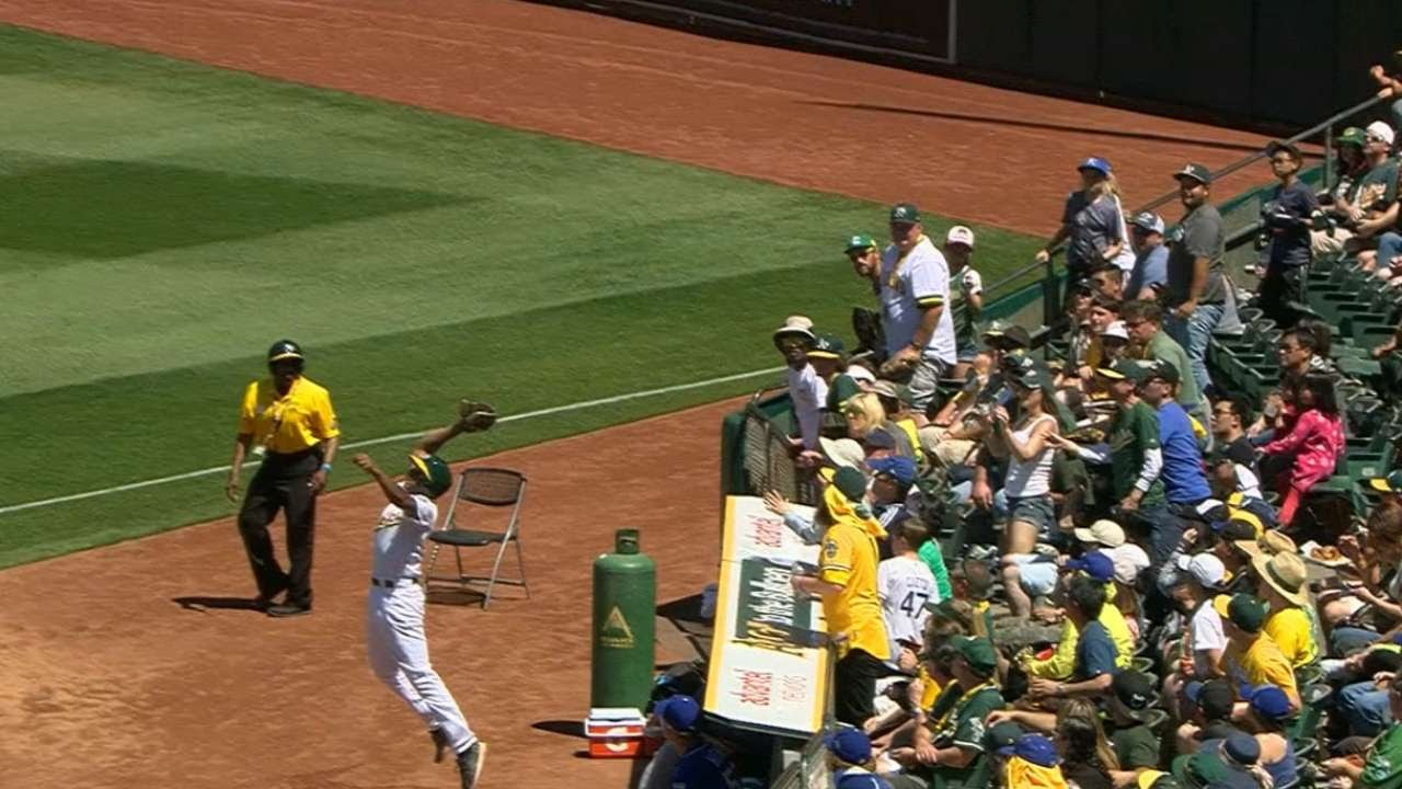 Oakland Athletics ball boy makes a nice jumping catch