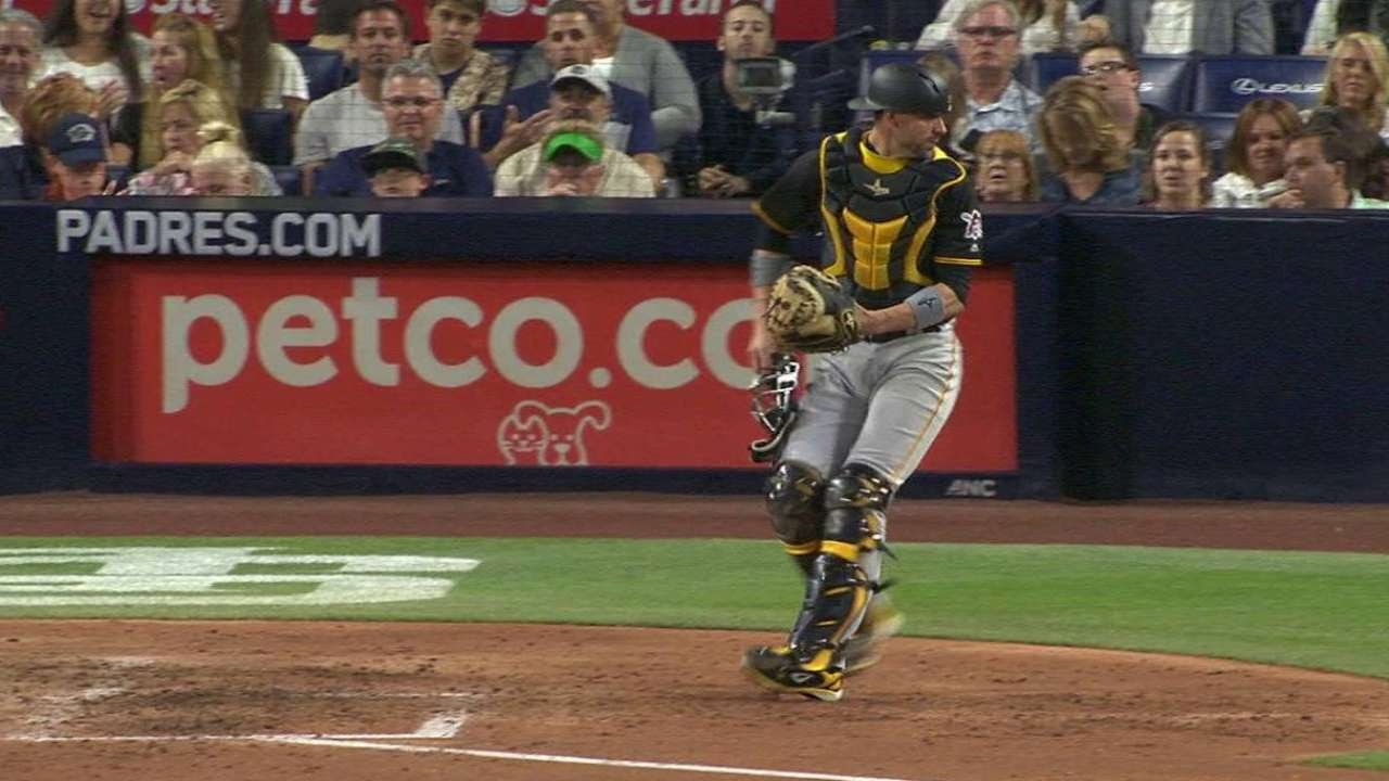 Wild pitch somehow winds up in umpires pocket during Pirates at Padres