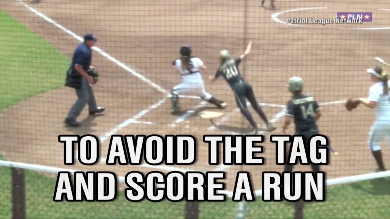 Army softball player jumps over catcher to score run