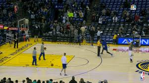 Stephen Curry hits half court shots during pre-game warmups