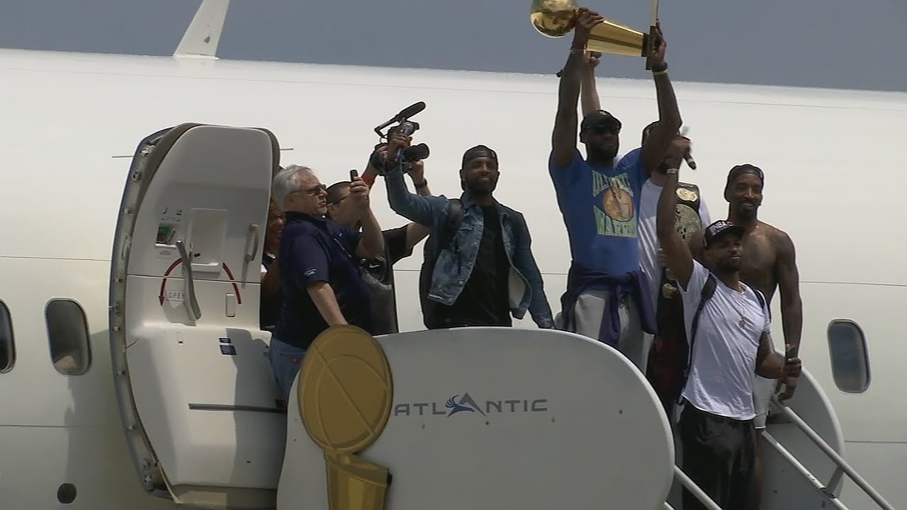 Cavaliers arrive in Cleveland for Championship Celebrations