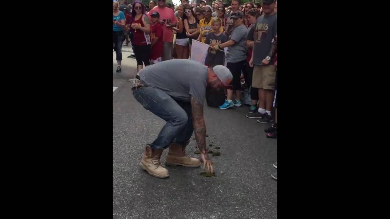 Cavs fan literally eats Horse Shit during Cavs Championship parade