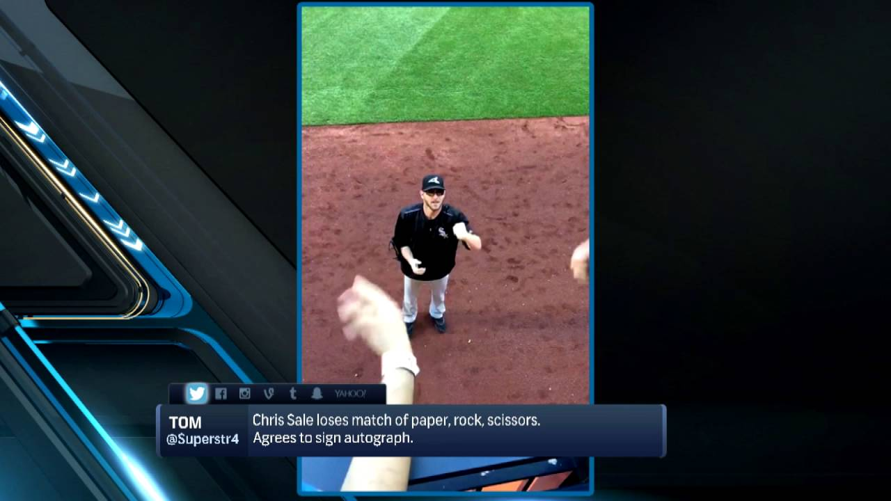 Chris Sale loses in rock, paper, scissors so he has to sign autograph