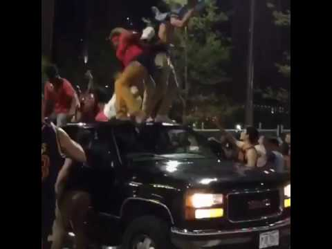 Driver knocks off Cavaliers fans jumping on his truck