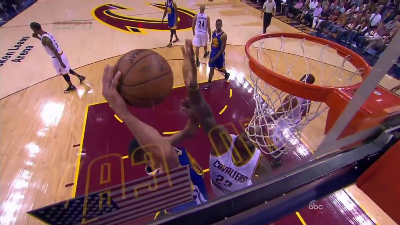 LeBron James blocks Steph Curry after the whistle