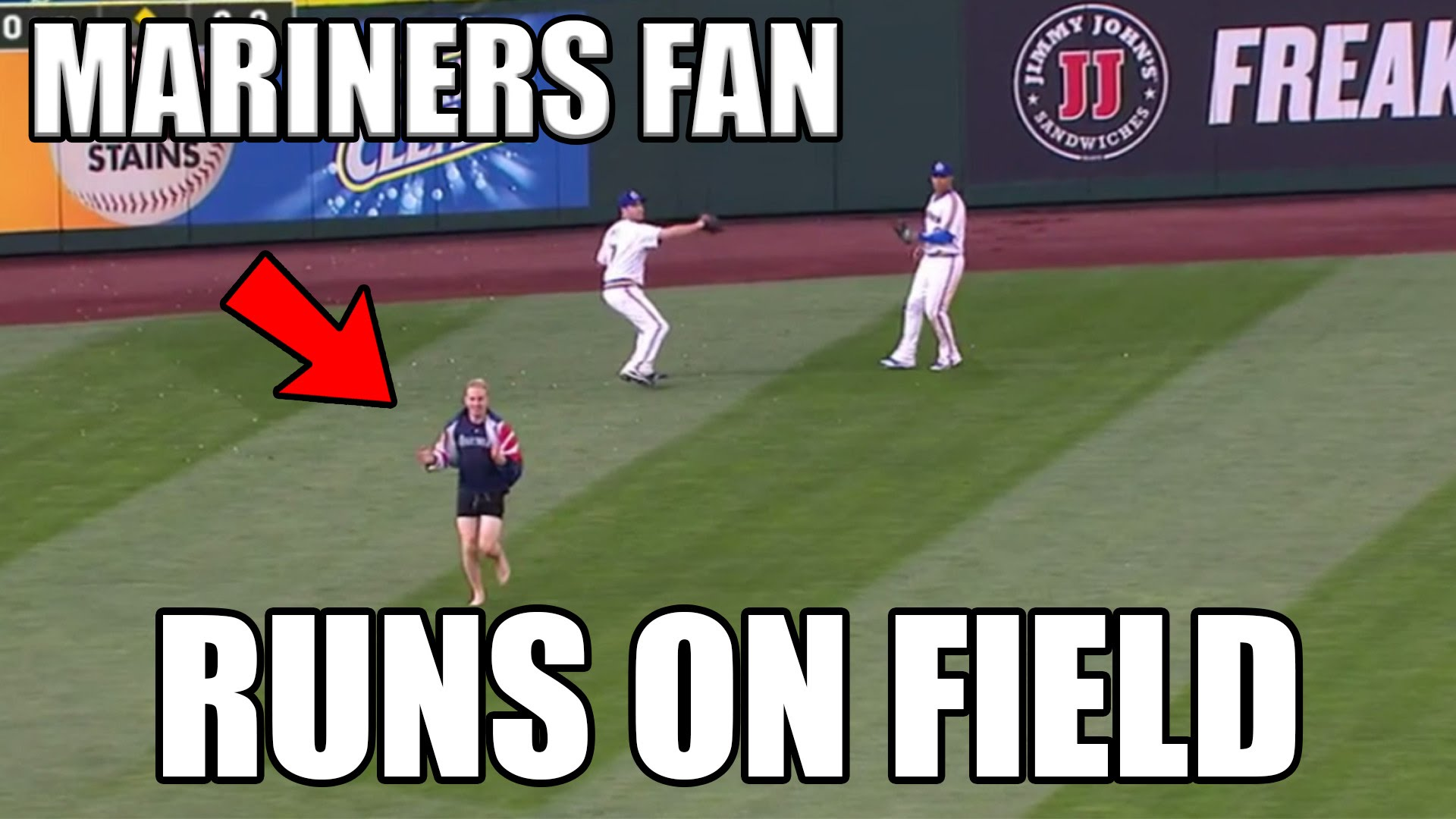 Seattle Mariners fan runs on the field during fly ball