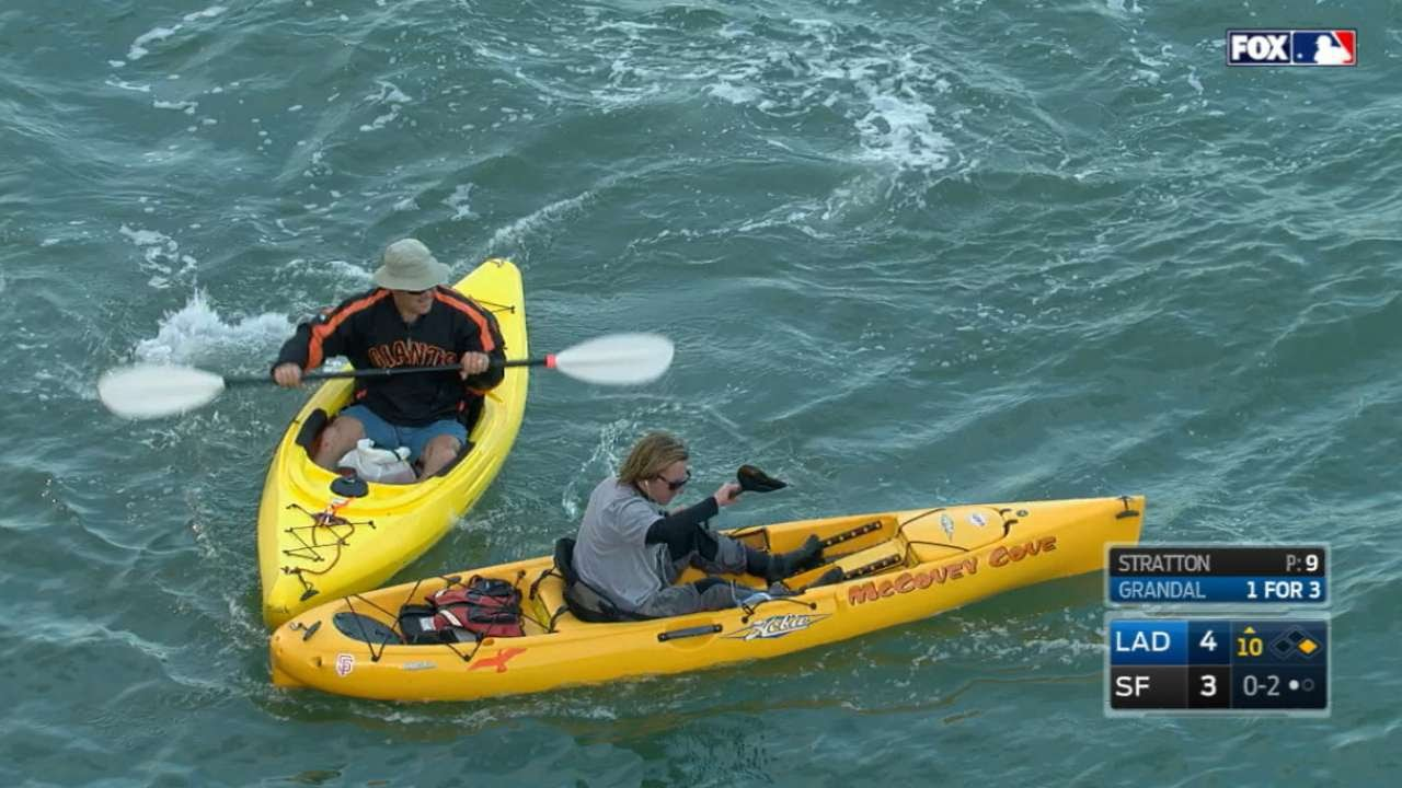 Two kayaks race for foul ball in McCovey Cove