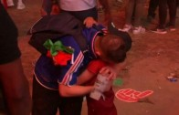 Portuguese boy hugs French fan after Euro 2016 Final