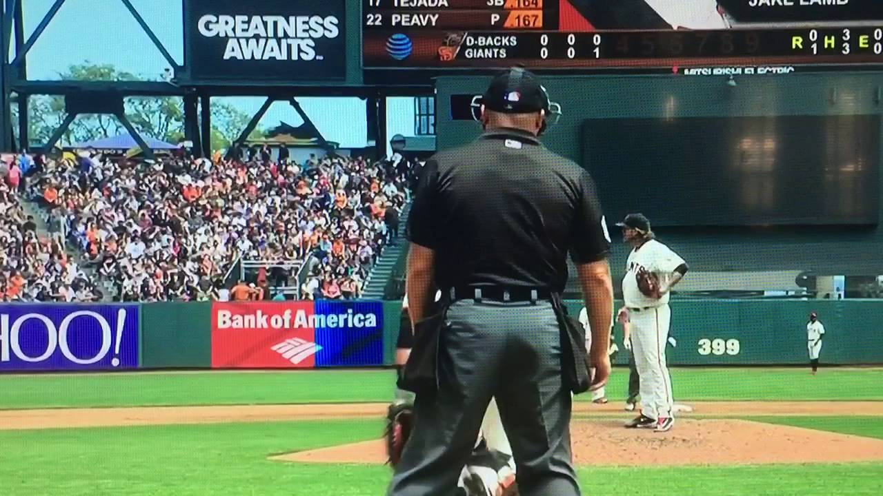 Buster Posey throws ball into Jake Peavy's glove while he's not looking