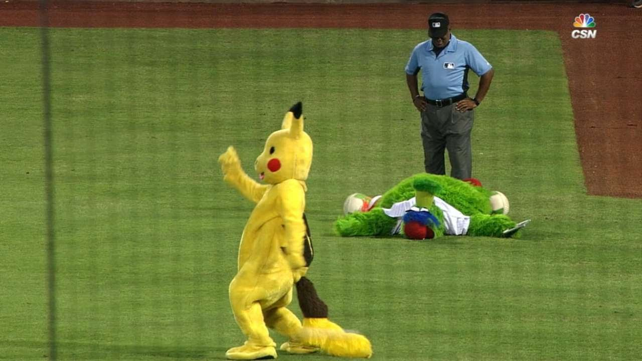 Philly Phanatic captures Pikachu during Phillies game