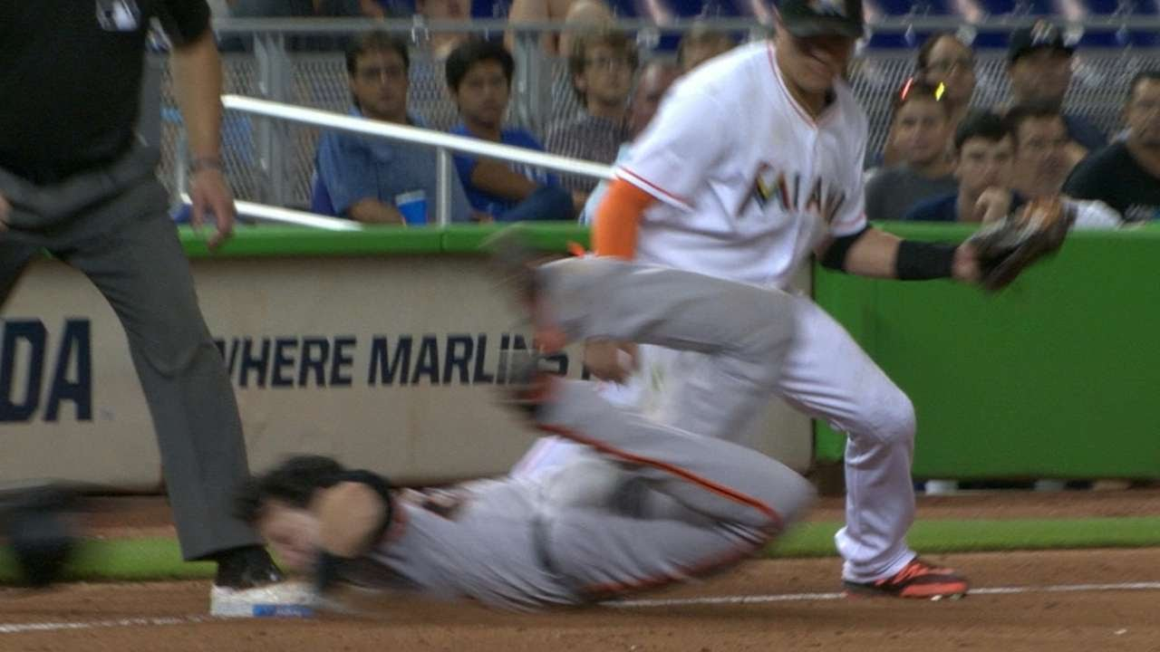 Buster Posey slides into 3rd base with his head hitting the bag