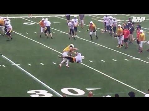 High schooler lays a bone crushing hit in scrimmage