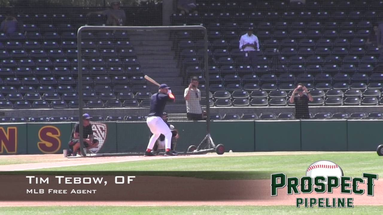 Tim Tebow performs baseball drills for MLB scouts