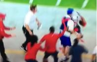 Julian Edelman crashes into a ball boy during Sunday Night Football