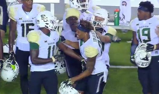 Baylor's kicker shoves his own teammate on the sidelines