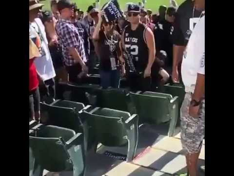Raiders fan gets clocked for knocking glasses of another Raiders fan