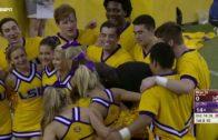 Shaq shoulder presses an LSU cheerleader