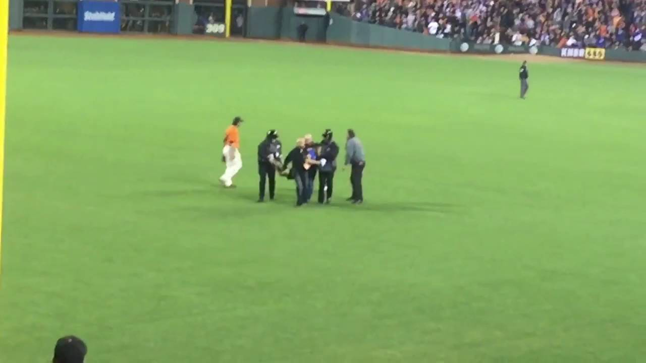 Angel Pagan suplexes a fan on the field at the Giants game
