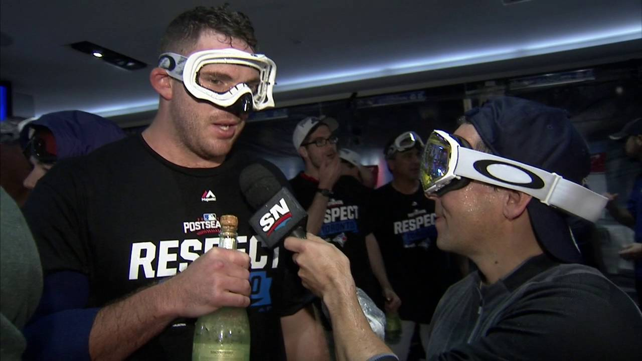 Blue Jays pitcher Joe Biagini pretends champagne bottle is a microphone