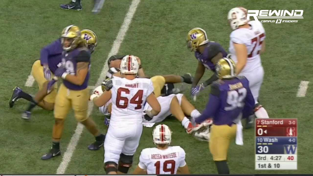 Christian McCaffrey gets tackled by a ref during Stanford vs. Washington