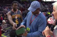 Atlanta rapper Gucci Mane gives away a Rolex watch to a fan at the Hawks game