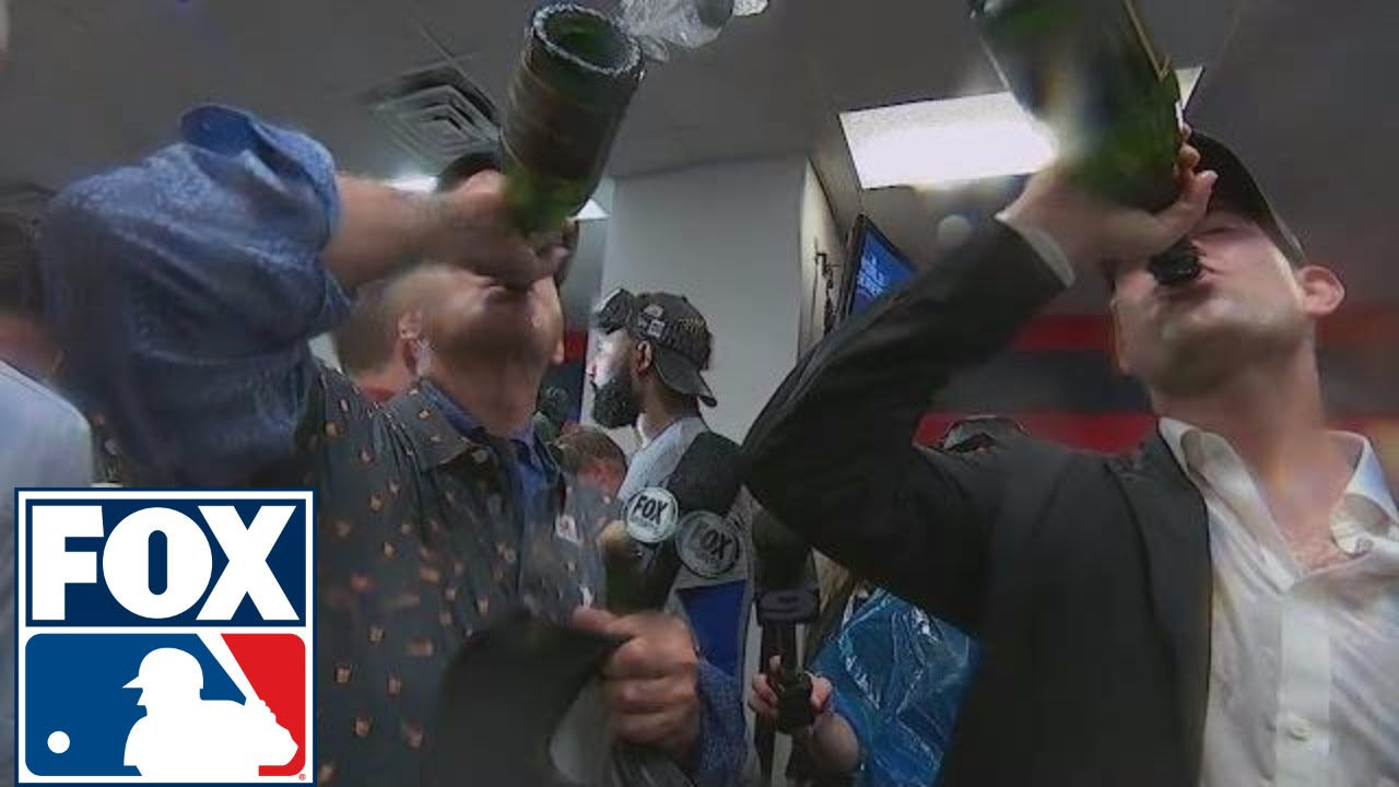 Bill Murray chugs champagne with Cubs president Theo Epstein