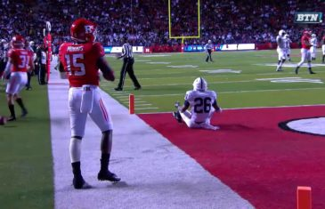 Fan throws a baseball on to the field during Penn State vs. Rutgers
