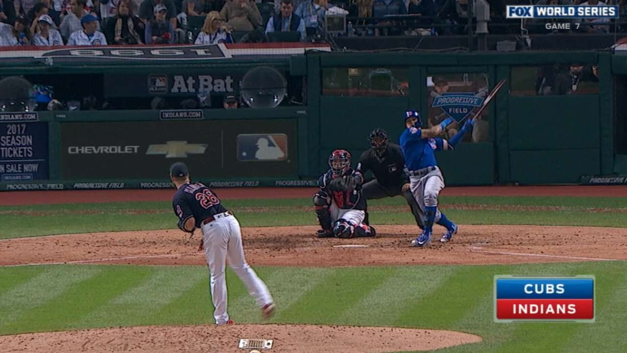 Javier Baez connects for a solo home run in Game 7