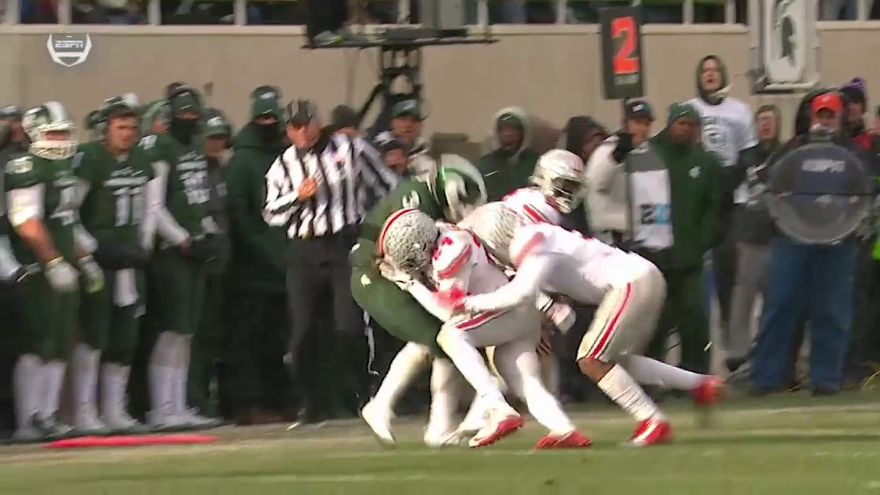 Michigan State's LJ Scott hurdles Ohio State defender