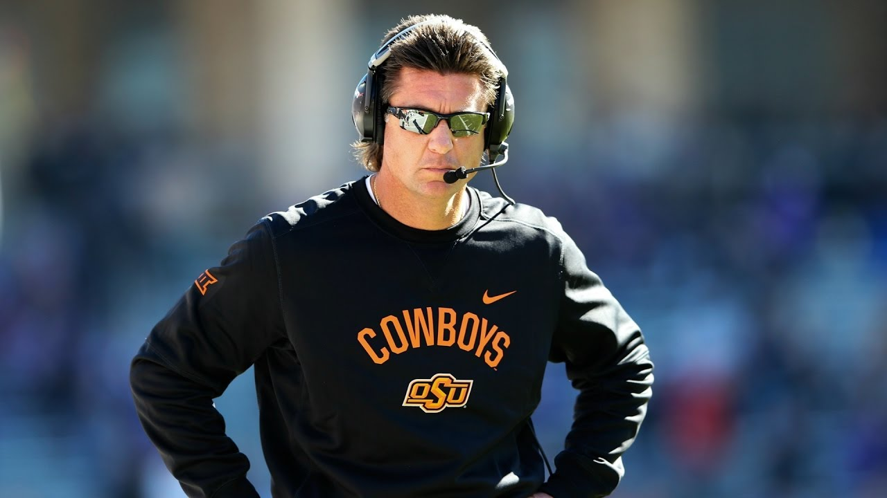 Oklahoma State head coach Mike Gundy gets popped in the face by his own player