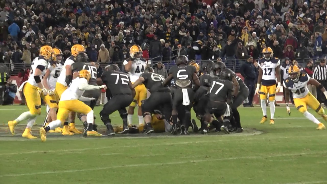 Army fans & students storm the field after their historic win over Navy