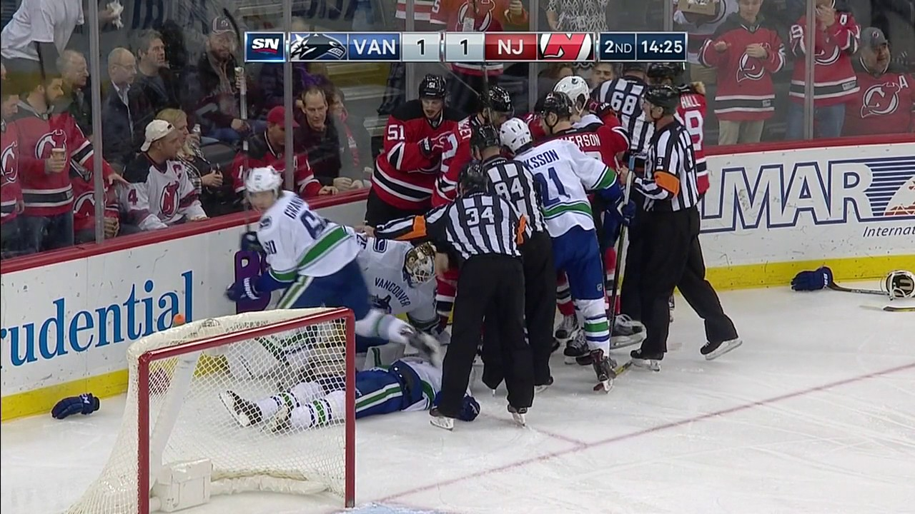 Canucks & Devils brawl while Philip Larsen is knocked out unconscious