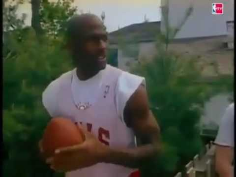 Michael Jordan throws a football 65 yards with ease