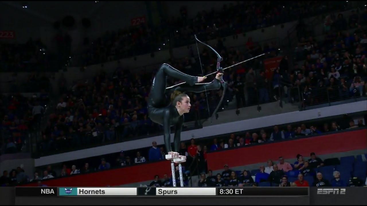 Florida Gators halftime performer shoots an arrow with her foot