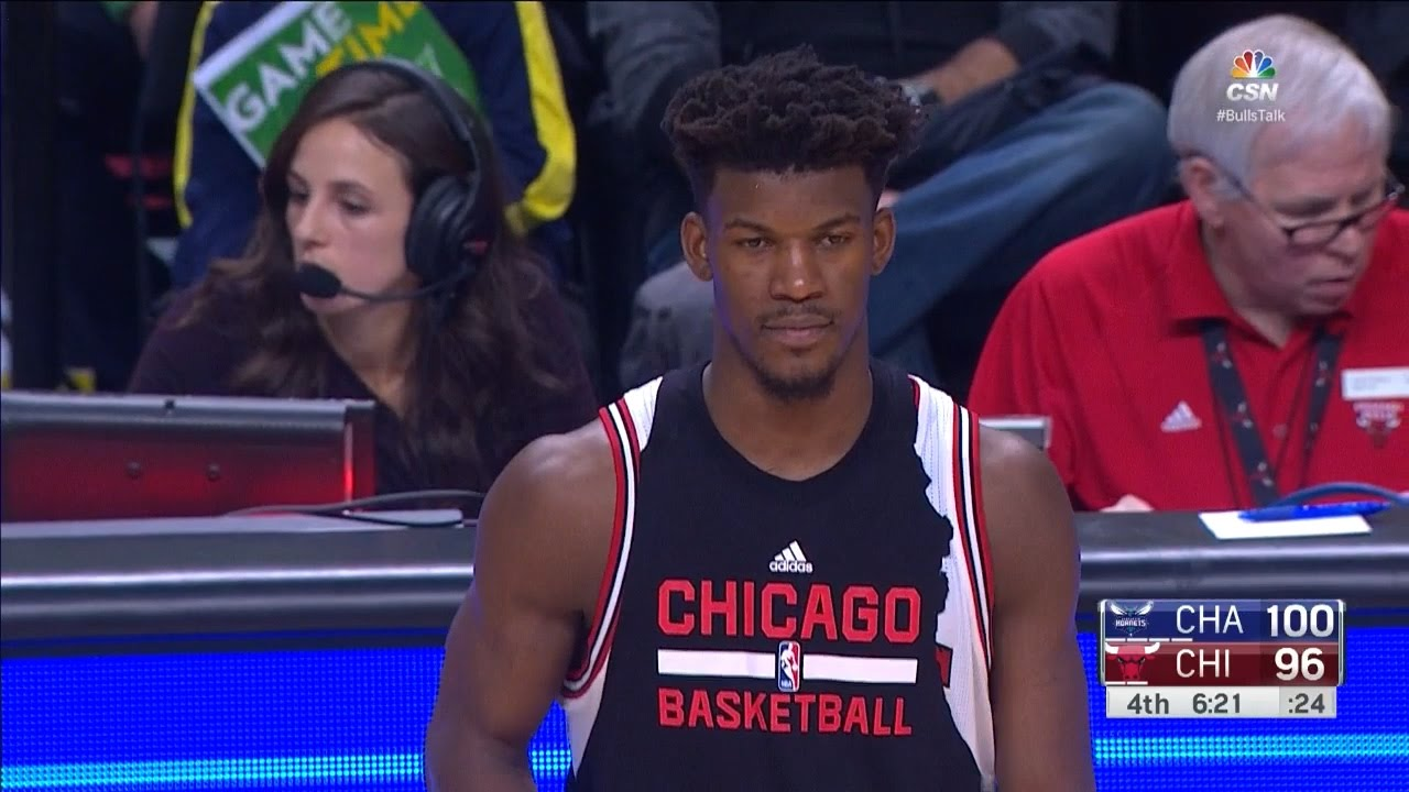 Jimmy Butler forgets to remove his ripped warm up shirt
