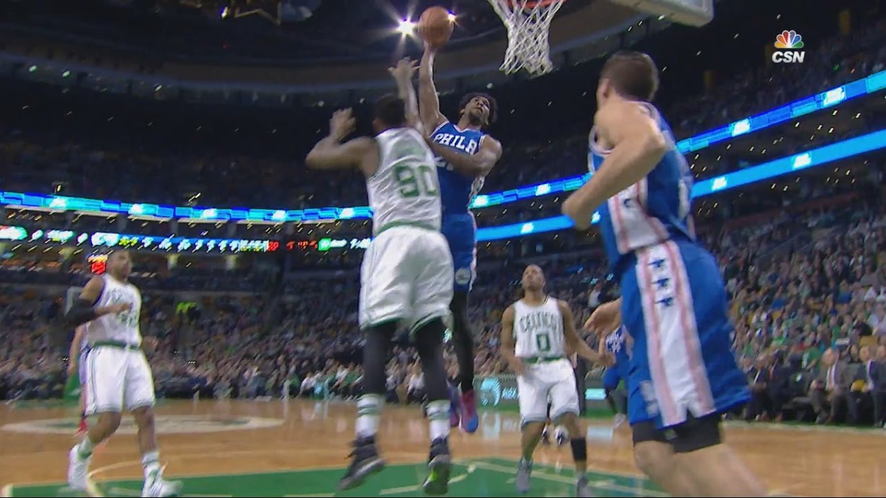 Joel Embiid posterizes Amir Johnson in Boston
