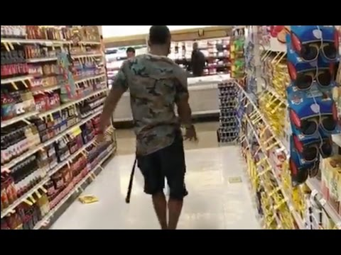 Raiders punter Marquette King punts food at a grocery store