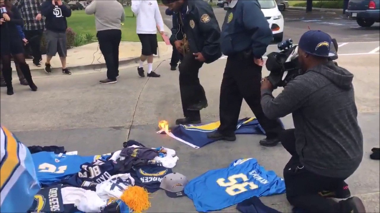 San Diego Chargers fan attempts to burn team flag at Chargers headquarters